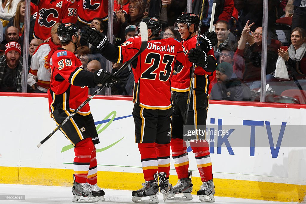 Sean Monahan #23, <a gi-track='captionPersonalityLinkClicked' href=/galleries/search?phrase=T.J.+Galiardi&family=editorial&specificpeople=4324979 ng-click='$event.stopPropagation()'>T.J. Galiardi</a> #39 and <a gi-track='captionPersonalityLinkClicked' href=/galleries/search?phrase=Joe+Colborne&family=editorial&specificpeople=5370968 ng-click='$event.stopPropagation()'>Joe Colborne</a> #8 of the Calgary Flames celebrate a goal against the San Jose Sharks at Scotiabank Saddledome on January 30, 2014 in Calgary, Alberta, Canada.