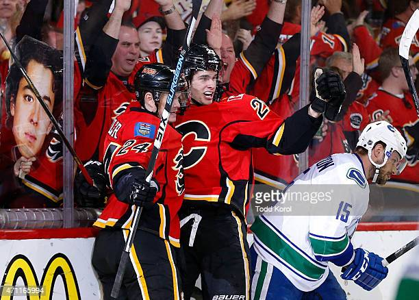 Sean Monohan celebrates his goal with Jiri Hudler of the Calgary Flames while Brad Richardson of the Vancouver Canucks skates away in Game Six of the...