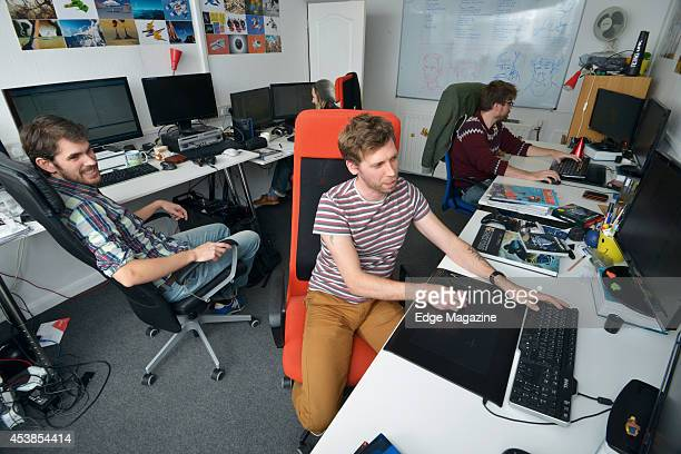 Sean Murray Grant Duncan and David Ream of English video games developer Hello Games photographed at their studio in Guildford on December 12 2013