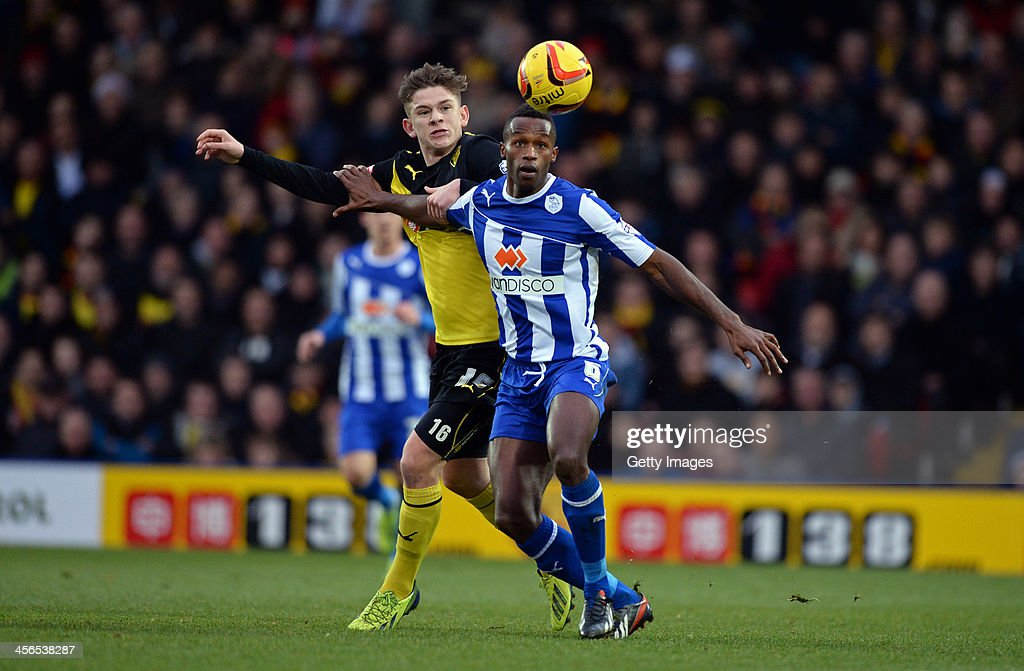 Sean Murray of Watford is challenged by Jose Semedo of Sheffield Wednesday during the the Sky Bet Championship match between Watford and Sheffield Wednesday at Vicarage Road on December 14, 2013 in Watford, England,