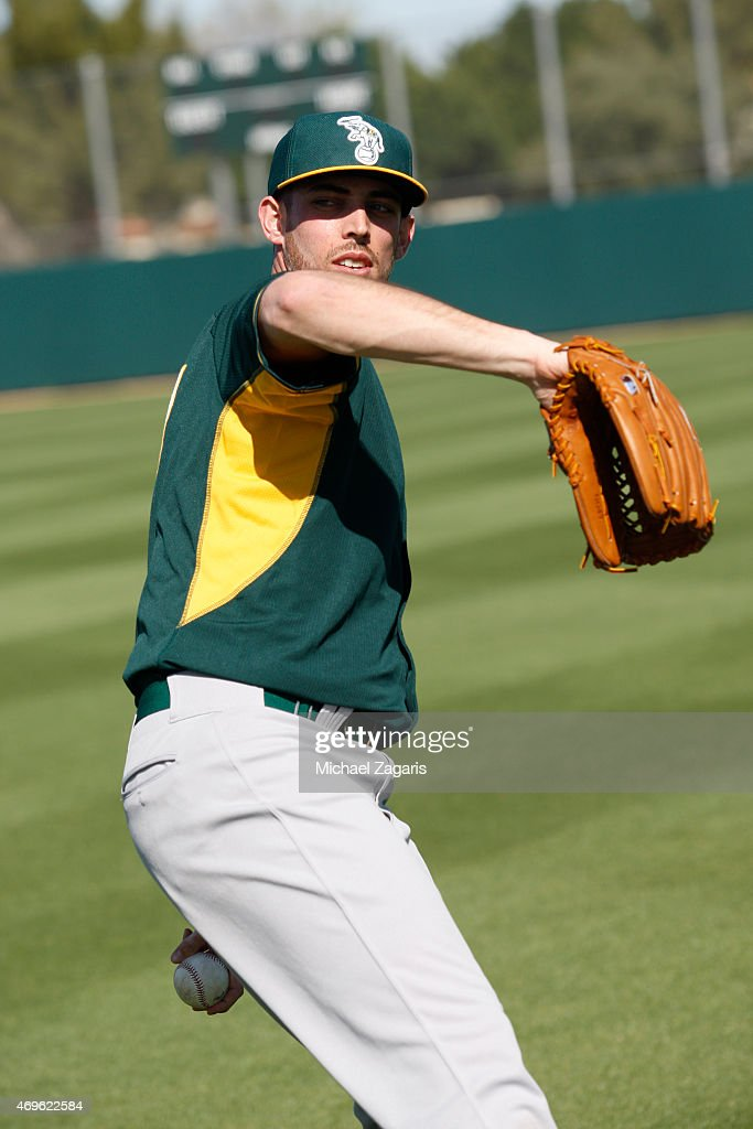 Sean Nolin of the Oakland Athletics throws the ball during a workout at Fitch Park on February 27 2015 in Mesa Arizona