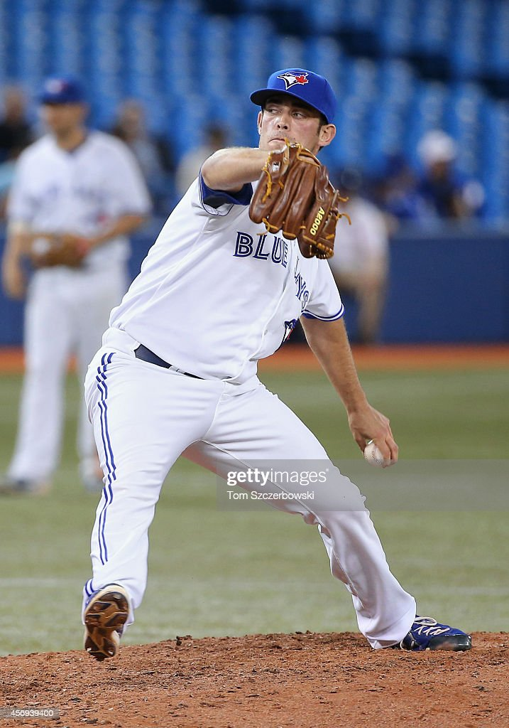 Sean Nolin of the Toronto Blue Jays delivers a pitch in the ninth inning during MLB game action against the Seattle Mariners on September 22 2014 at...