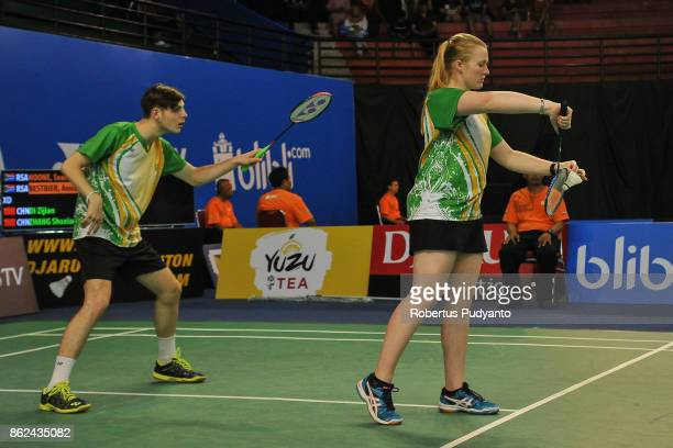 Sean Noone and Anicka Bestbier of Republic South Africa compete against Di Zijian and Zhang Shuxian of China during Mixed Double qualification round...