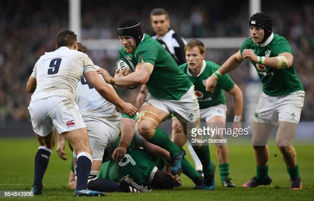 Sean O'Brien of Ireland charges towards Ben Youngs of England during the RBS Six Nations match between Ireland and England at the Aviva Stadium on...