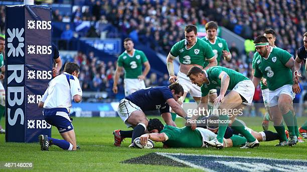 Sean O'Brien of Ireland goes over to score the fourth try during the RBS Six Nations match between Scotland and Ireland at Murrayfield on March 21...