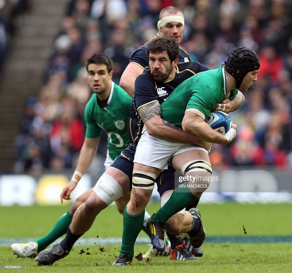 Sean O'Brien of Ireland (R) is tackled by Jim Hamilton of Scotland during the Six Nations international rugby union match between Scotland and Ireland at Murrayfield Stadium in Edinburgh on February 24, 2013.