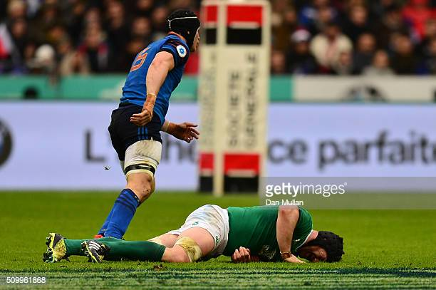 Sean O'Brien of Ireland lies injured during the RBS Six Nations match between France and Ireland at the Stade de France on February 13 2016 in Paris...