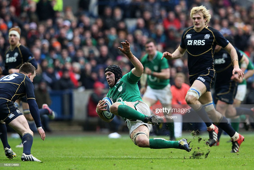 Sean O'Brien of Ireland looses his footing as he is challenged by Stuart Hogg of Scotland during the RBS Six Nations match between Scotland and Ireland at Murrayfield Stadium on February 24, 2013 in Edinburgh, Scotland.
