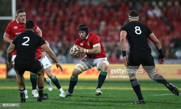 Sean O'Brien of the Lions charges towards Codie Taylor and Kieran Read of the All Blacks during the second test match between the New Zealand All...
