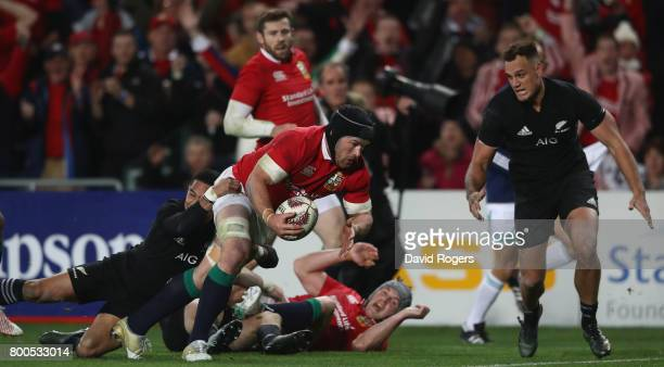 Sean O'Brien of the Lions dives over to score a try during the Test match between the New Zealand All Blacks and the British Irish Lions at Eden Park...