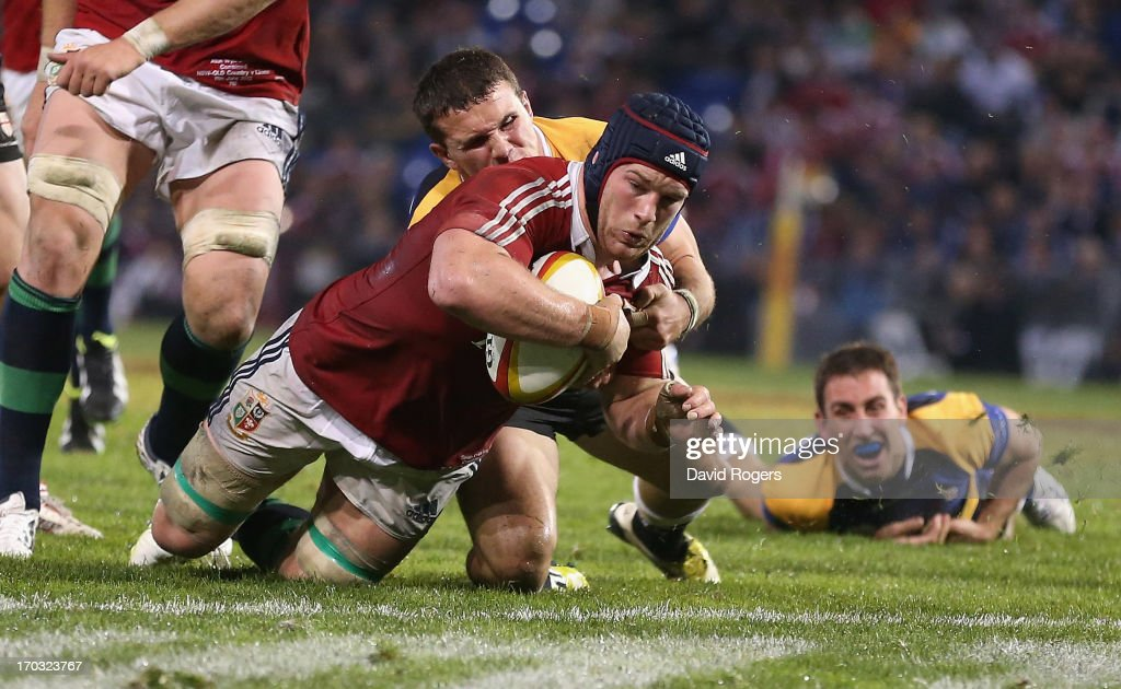 Sean O'Brien of the Lions dives to score a try during the match between Combined Country and the British & Irish Lions at Hunter Stadium on June 11, 2013 in Newcastle, Australia.
