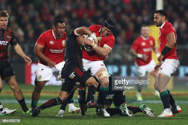 Sean O'Brien of the Lions is tackled by Bryn Hall of the Crusaders during the 2017 British Irish Lions tour match between the Crusaders and the...