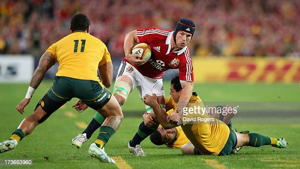 Sean O'Brien of the Lions is tackled by George Smith during the International Test match between the Australian Wallabies and British Irish Lions at...