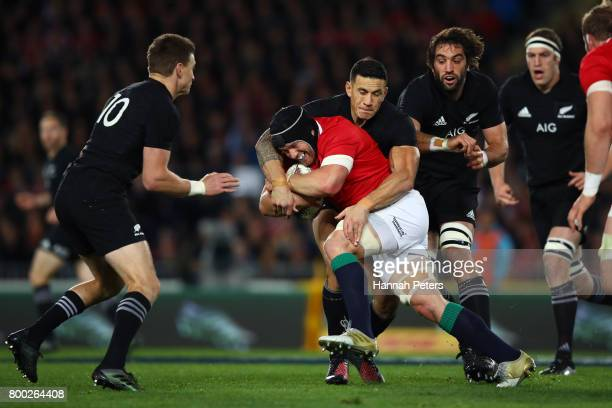Sean O'Brien of the Lions is tackled by Sonny Bill Williams of the All Blacks during the first test match between the New Zealand All Blacks and the...