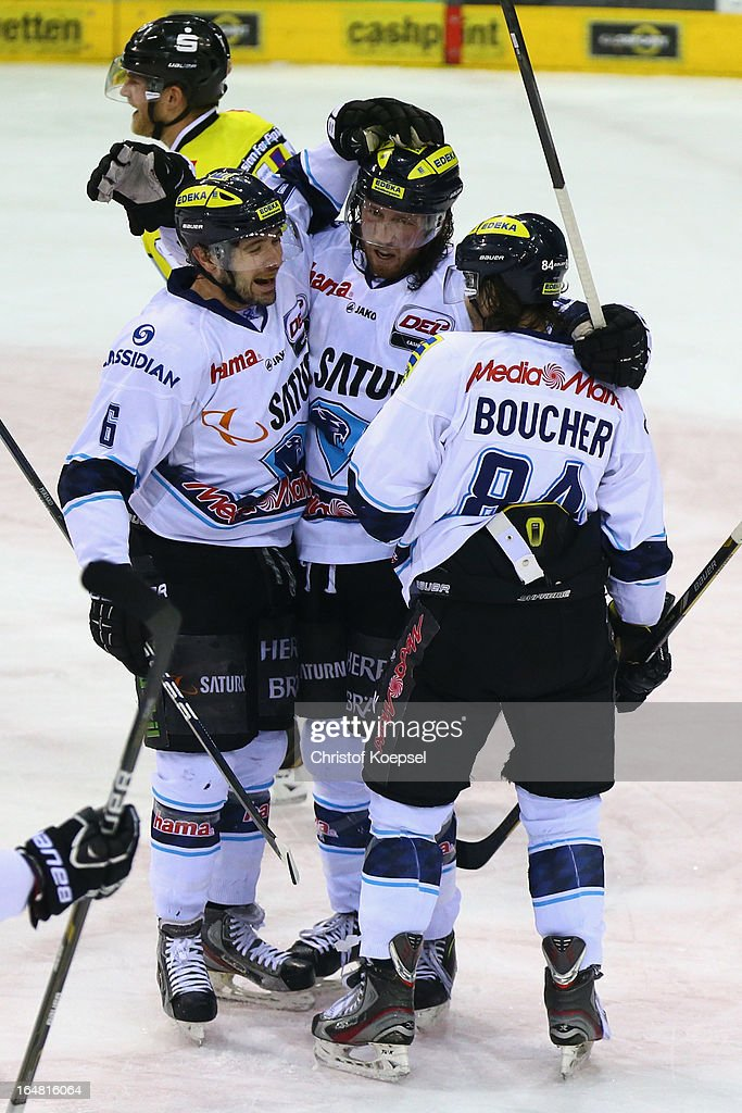 Sean O'Connor (C) of ERC Ingolstadt celebrates the second goal with Michel Periard (L) and Jean-Francois Boucher (R) during the fifth DEL Play-Off-match between Krefeld Pinguine and ERC Ingolstadt at Koenigspalast on March 28, 2013 in Wuppertal, Germany.