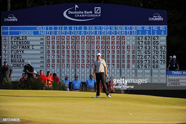 Sean O'Hair reacts to missing an eagle putt in front of the leaderboard on the 18th hole green during the final round of the Deutsche Bank...