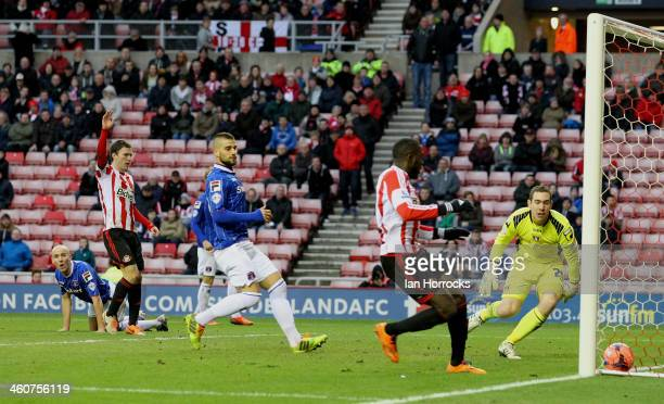 Sean O'Hanlon of Carlisle United watches his deflection take the ball past his keeper for Sunderland's second goal during the Budweiser FA Cup third...