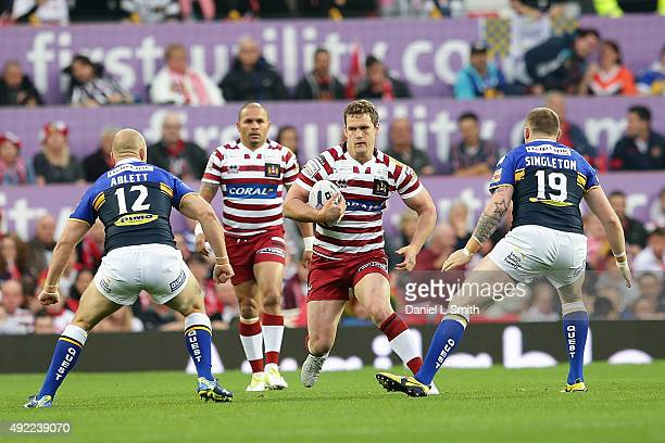 Sean OÕLoughlin of Wigan Warriors is confronted by Carl Ablett and Brad Singleton of Leeds Rhinos during the First Utility Super League Grand Final...