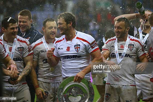 Sean O'Loughlin the captain of England holds the winners trophy alongside Brett Ferres James Roby and Josh Hodgson after clinching the series 21...