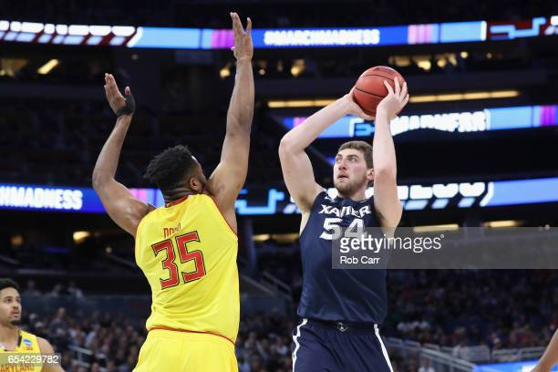Sean O'Mara of the Xavier Musketeers shoots the ball against Damonte Dodd of the Maryland Terrapins in the first half during the first round of the...