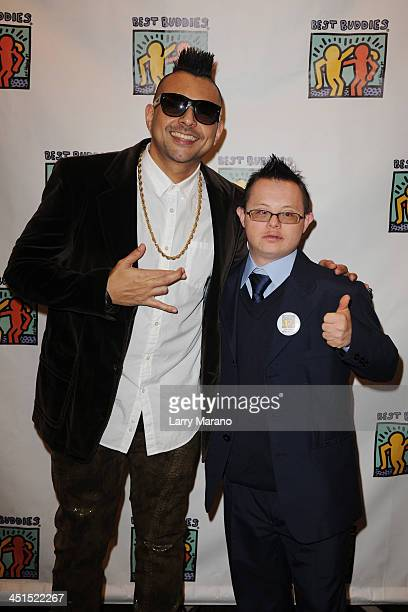 Sean Paul poses with a buddy backstage at The Seventeenth Annual Best Buddies Miami Gala at Fontainebleau Miami Beach on November 22 2013 in Miami...