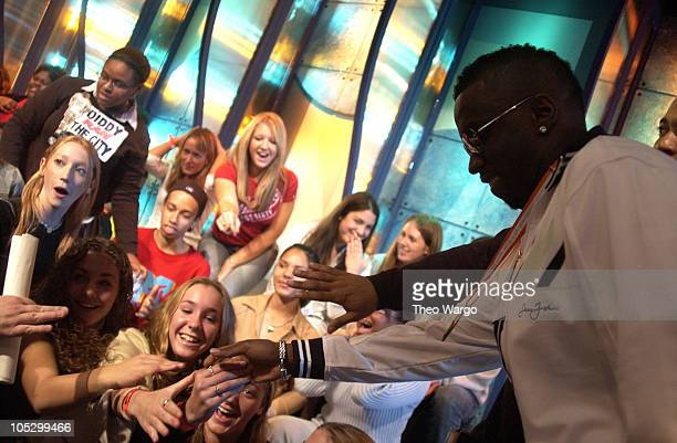 Sean 'PDiddy' Combs greets TRL audience members during Sean 'PDiddy' Combs and Mya Visit MTV's 'TRL' November 4 2003 at MTV Studios Times Square in...