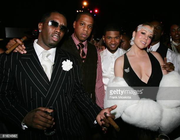 Sean 'PDiddy' Combs JayZ Usher and Mariah Carey at the 26th Birthday party for Usher October 17 2004 at the Rainbow Room in New York City The party...