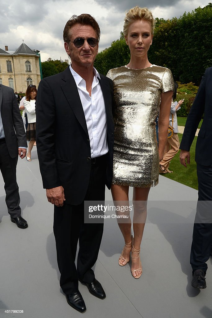 <a gi-track='captionPersonalityLinkClicked' href=/galleries/search?phrase=Sean+Penn&family=editorial&specificpeople=202979 ng-click='$event.stopPropagation()'>Sean Penn</a> and <a gi-track='captionPersonalityLinkClicked' href=/galleries/search?phrase=Charlize+Theron&family=editorial&specificpeople=171250 ng-click='$event.stopPropagation()'>Charlize Theron</a> attend at the Christian Dior show as part of Paris Fashion Week - Haute Couture Fall/Winter 2014-2015 at on July 7, 2014 in Paris, France.