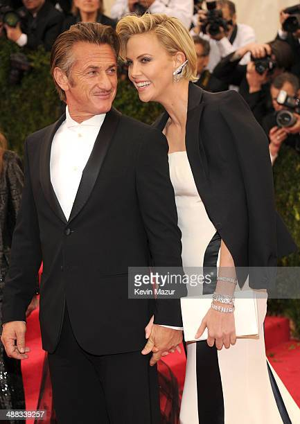 Sean Penn and Charlize Theron attend the 'Charles James Beyond Fashion' Costume Institute Gala at the Metropolitan Museum of Art on May 5 2014 in New...