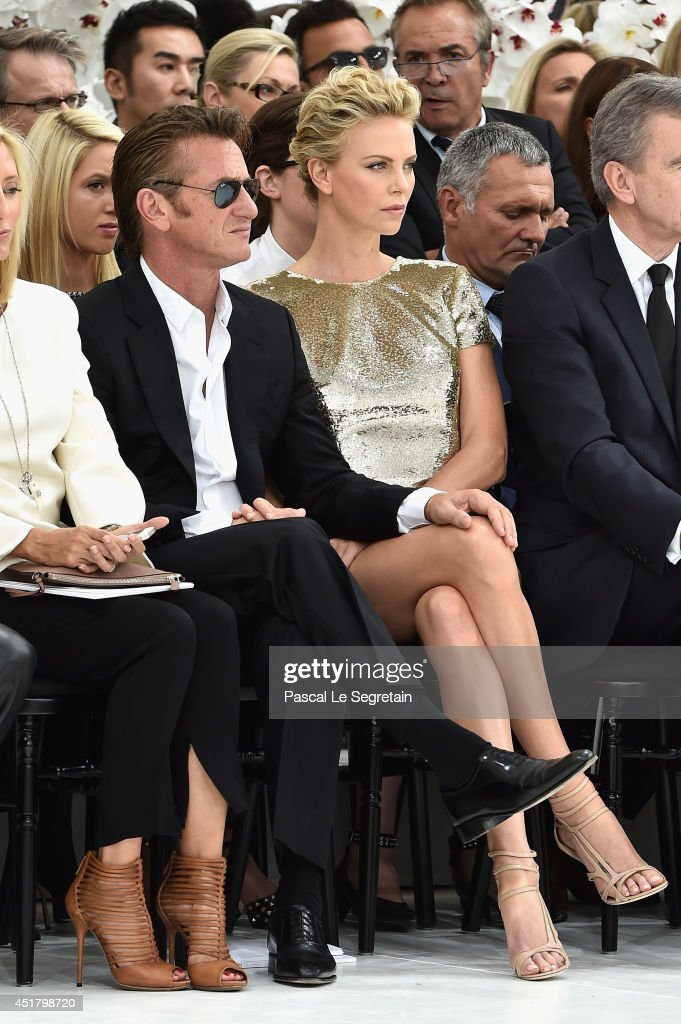 <a gi-track='captionPersonalityLinkClicked' href=/galleries/search?phrase=Sean+Penn&family=editorial&specificpeople=202979 ng-click='$event.stopPropagation()'>Sean Penn</a> and <a gi-track='captionPersonalityLinkClicked' href=/galleries/search?phrase=Charlize+Theron&family=editorial&specificpeople=171250 ng-click='$event.stopPropagation()'>Charlize Theron</a> attend the Christian Dior show as part of Paris Fashion Week - Haute Couture Fall/Winter 2014-2015 on July 7, 2014 in Paris, France.