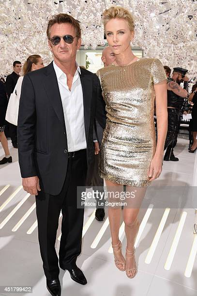 Sean Penn and Charlize Theron attend the Christian Dior show as part of Paris Fashion Week Haute Couture Fall/Winter 20142015 on July 7 2014 in Paris...