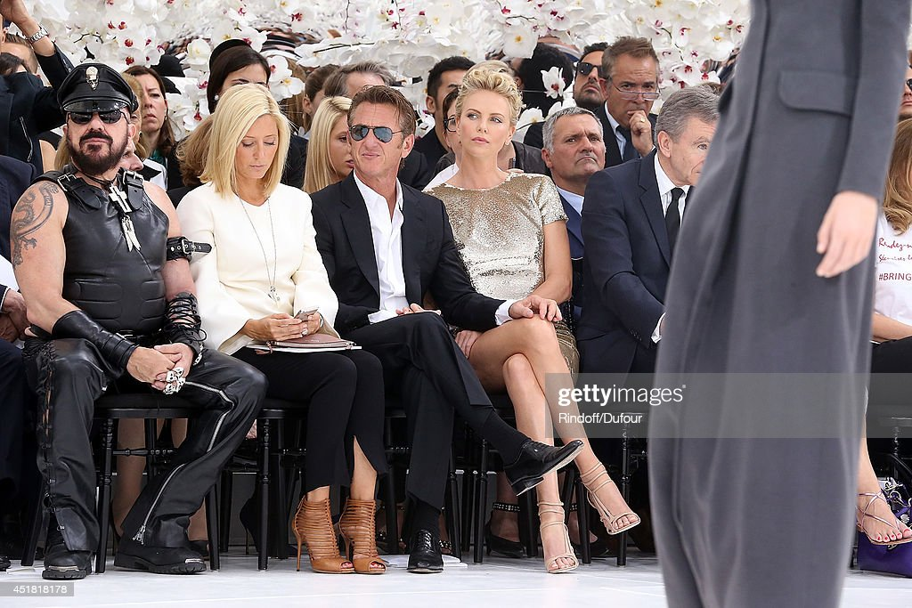 Sean Penn and Charlize Theron attend the Christian Dior show as part of Paris Fashion Week - Haute Couture Fall/Winter 2014-2015 at Muse Rodin on July 7, 2014 in Paris, France.