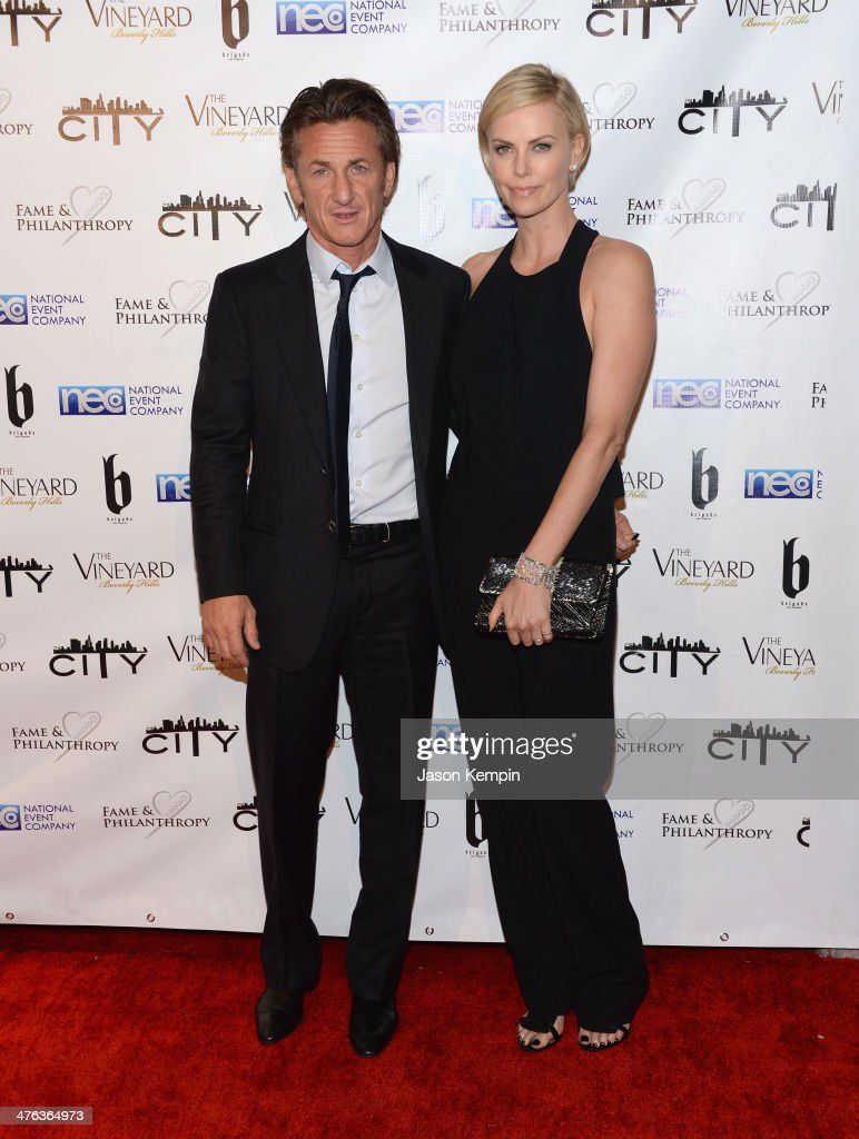 <a gi-track='captionPersonalityLinkClicked' href=/galleries/search?phrase=Sean+Penn&family=editorial&specificpeople=202979 ng-click='$event.stopPropagation()'>Sean Penn</a> and <a gi-track='captionPersonalityLinkClicked' href=/galleries/search?phrase=Charlize+Theron&family=editorial&specificpeople=171250 ng-click='$event.stopPropagation()'>Charlize Theron</a> attend the Fame and Philanthropy Post-Oscar Party at The Vineyard on March 2, 2014 in Beverly Hills, California.