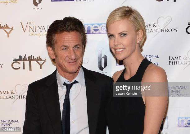 Sean Penn and Charlize Theron attend the Fame and Philanthropy PostOscar Party at The Vineyard on March 2 2014 in Beverly Hills California