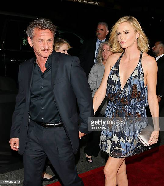 Sean Penn and Charlize Theron attend the premiere of Open Road Films' 'The Gunman' at Regal Cinemas LA Live on March 12 2015 in Los Angeles California