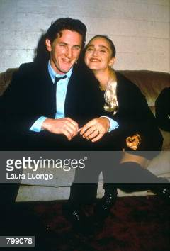 Sean Penn and Madonna relax while attending an AIDS benefit November 11 1987 in Los Angeles