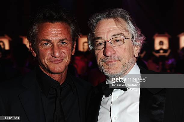 Sean Penn and Robert De Niro attend amfAR's Cinema Against AIDS Gala during the 64th Annual Cannes Film Festival at Hotel Du Cap on May 19 2011 in...