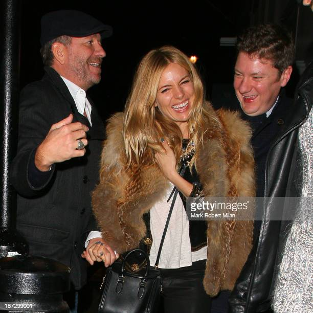 Sean Pertwee and Sienna Miller leaving the Groucho club on November 7 2013 in London England