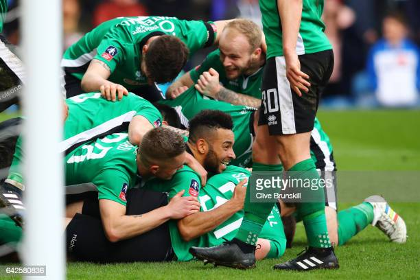 Sean Raggett of Lincoln City celebrates scoring his sides first goal with his Lincoln City team mates during The Emirates FA Cup Fifth Round match...