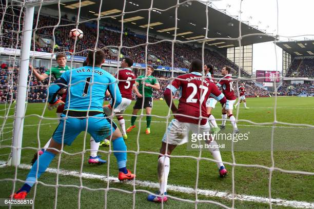 Sean Raggett of Lincoln City scores his sides first goal during The Emirates FA Cup Fifth Round match between Burnley and Lincoln City at Turf Moor...