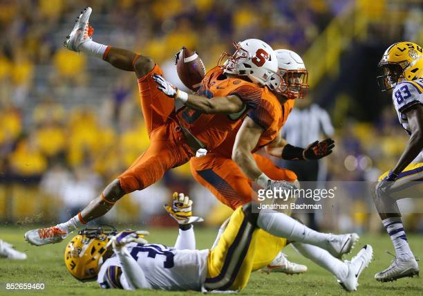 Sean Riley of the Syracuse Orange is tackled by Eric Monroe of the LSU Tigers during the second half of a game at Tiger Stadium on September 23 2017...