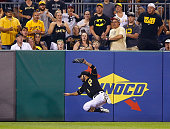 Sean Rodriguez of the Pittsburgh Pirates catches a fly ball hit by Mark Reynolds of the St Louis Cardinals in the 13th inning during the game at PNC...