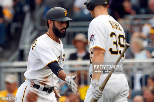 Sean Rodriguez of the Pittsburgh Pirates celebrates after scoring on a double play in the second inning against the St Louis Cardinals at PNC Park on...