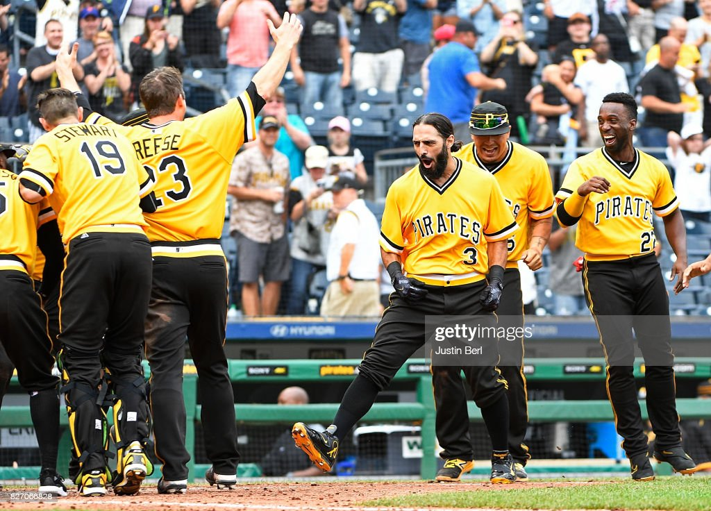 Sean Rodriguez #3 of the Pittsburgh Pirates celebrates with teammates as he rounds the bases after hitting a walk off home run to give the Pittsburgh Pirates a 5-4 win over the San Diego Padres in the 12th inning at PNC Park on August 6, 2017 in Pittsburgh, Pennsylvania.