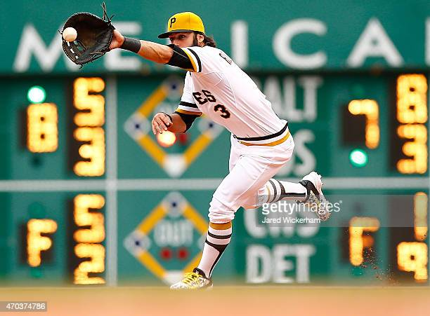 Sean Rodriguez of the Pittsburgh Pirates fields a ball at first base in the ninth inning against the Milwaukee Brewers during the game at PNC Park on...
