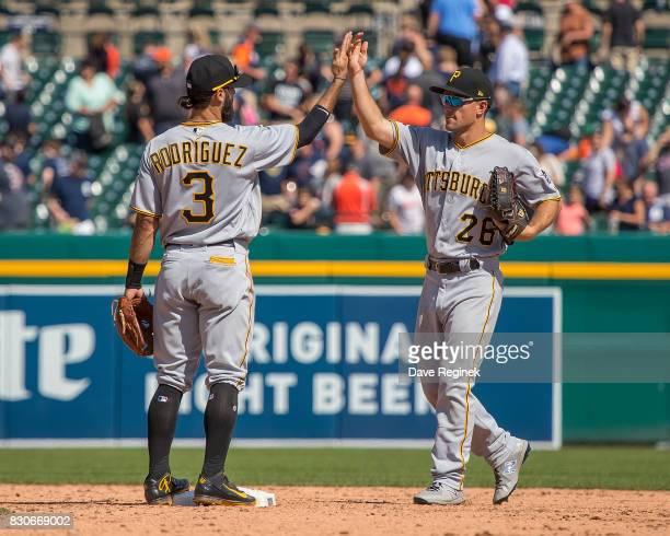Sean Rodriguez of the Pittsburgh Pirates hifives teammate Adam Frazier after defeating the Detroit Tigers 75 during a MLB game at Comerica Park on...