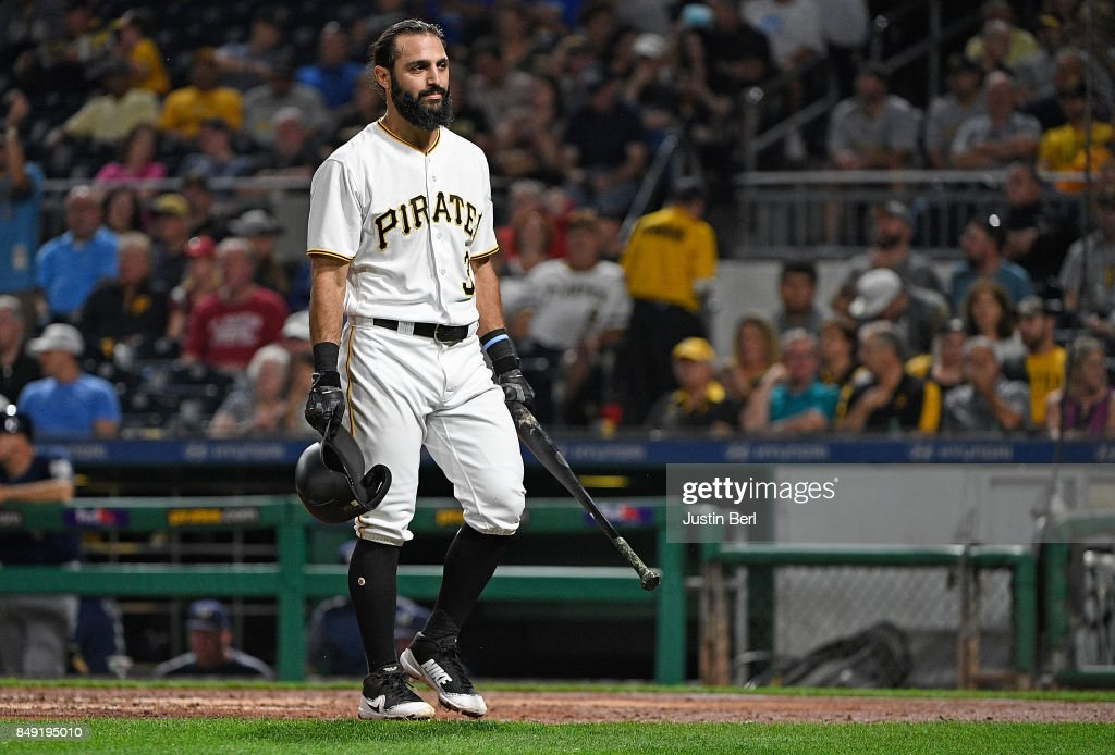 Sean Rodriguez #3 of the Pittsburgh Pirates walks back to the dugout after striking out in the fourth inning during the game against the Milwaukee Brewers at PNC Park on September 18, 2017 in Pittsburgh, Pennsylvania.