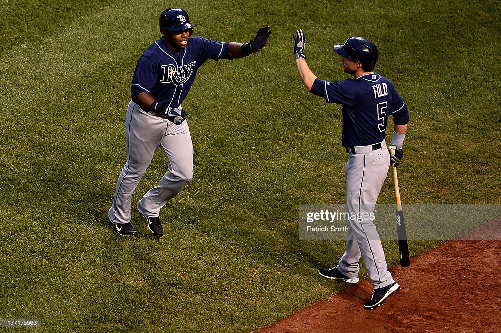 <a gi-track='captionPersonalityLinkClicked' href=/galleries/search?phrase=Sean+Rodriguez&family=editorial&specificpeople=4171805 ng-click='$event.stopPropagation()'>Sean Rodriguez</a> #1 of the Tampa Bay Rays celebrates with teammate <a gi-track='captionPersonalityLinkClicked' href=/galleries/search?phrase=Sam+Fuld&family=editorial&specificpeople=4505687 ng-click='$event.stopPropagation()'>Sam Fuld</a> #5 after hitting a home run in the second inning at Oriole Park at Camden Yards on August 21, 2013 in Baltimore, Maryland.