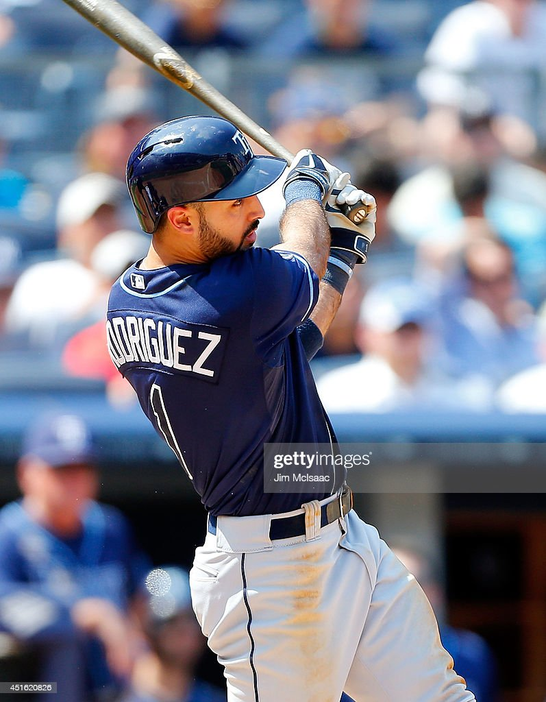 <a gi-track='captionPersonalityLinkClicked' href=/galleries/search?phrase=Sean+Rodriguez&family=editorial&specificpeople=4171805 ng-click='$event.stopPropagation()'>Sean Rodriguez</a> #1 of the Tampa Bay Rays follows through on a sixth inning two run home run against the New York Yankees at Yankee Stadium on July 2, 2014 in the Bronx borough of New York City.