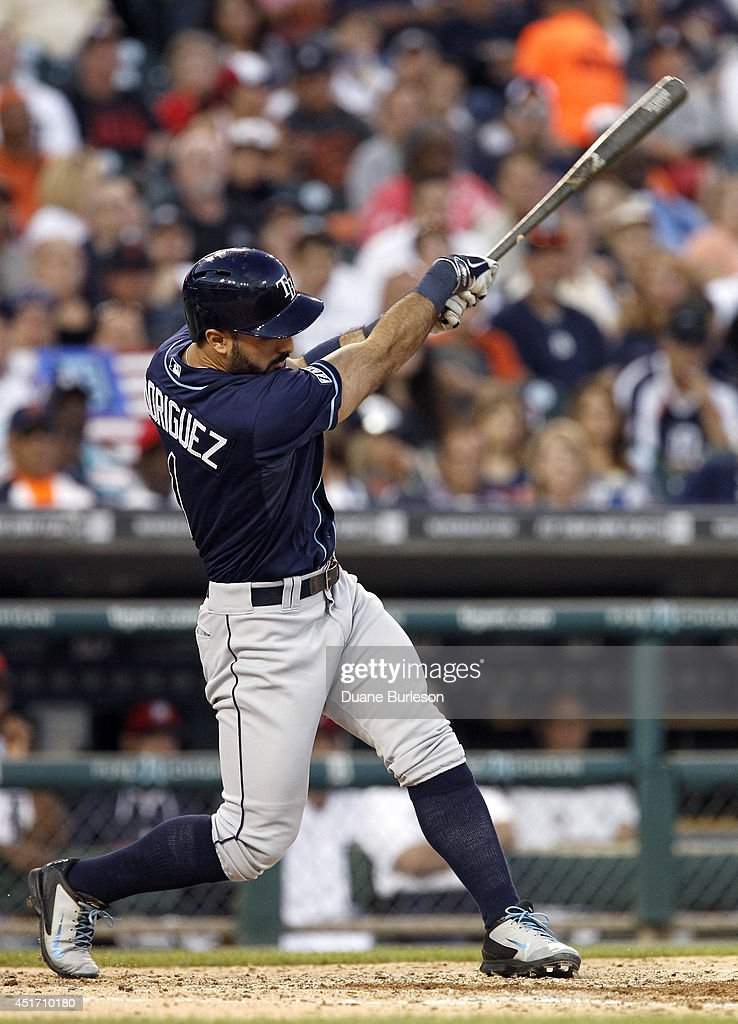 Sean Rodriguez #1 of the Tampa Bay Rays hits a two-run triple against the Detroit Tigers during the sixth inning at Comerica Park on July 4, 2014 in Detroit, Michigan.